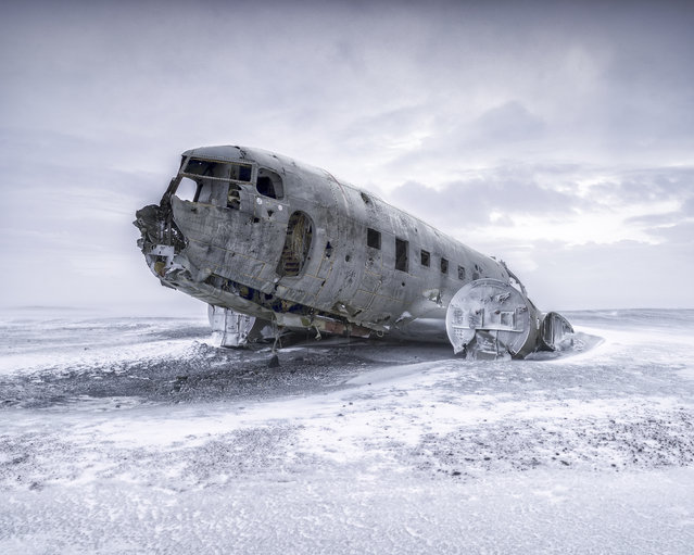 """DC3 Wreck"". A capture of a US military DC3 plane wreck at the southern black beach in Iceland. Photo location: Iceland. (Photo and caption by Naian Feng/National Geographic Photo Contest)"