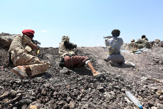 Soldiers and tribal fighters loyal to Yemen's government lie on the ground as they shoot at the frontline of fighting against Houthi militants in the central province of Marib October 7, 2015. (Photo by Reuters/Stringer)