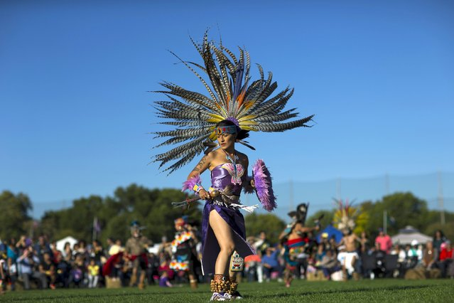 "A reveller dances during a ""pow-wow"" celebrating the Indigenous Peoples' Day Festival in Randalls Island, New York, October 11, 2015. (Photo by Eduardo Munoz/Reuters)"