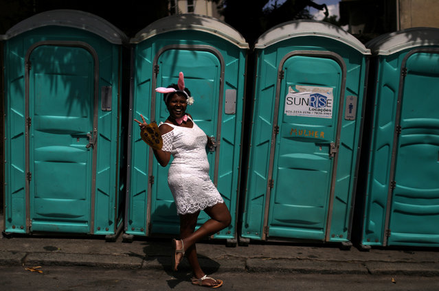 "A reveller takes part in an annual block party known as ""Ceu na Terra"" (Heaven on Earth), during carnival festivities in Rio de Janeiro, Brazil February 3, 2018. (Photo by Pilar Olivares/Reuters)"