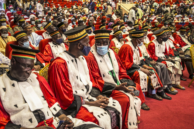 Delegates attend a ceremony to swear in the transitional president and vice president in the capital Bamako, Mali, Friday, September 25, 2020. Mali's transitional president and vice president were sworn into office Friday, more than a month after a coup in the West African nation, as Mali remains under sanctions by the 15-nation West African regional bloc ECOWAS, and amid uncertainty about details of the transition period. (Photo by AP Photo/Stringer)