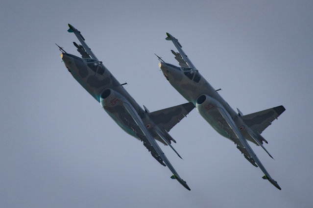This photo taken on September 24, 2016 shows Sukhoi SU-25 aircraft performing during the first Wonsan Friendship Air Festival in Wonsan. (Photo by Ed Jones/AFP Photo)