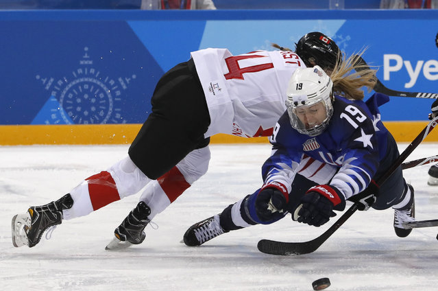 Renata Fast of Canada and Gigi Marvin of USA during the Women' s Ice Hockey Gold Medal Game between Canada and the United States at the Gangneung Hockey Centre in Gangneung during the Pyeongchang 2018 Winter Olympics on February 22, 2018. (Photo by Grigory Dukor/Reuters)