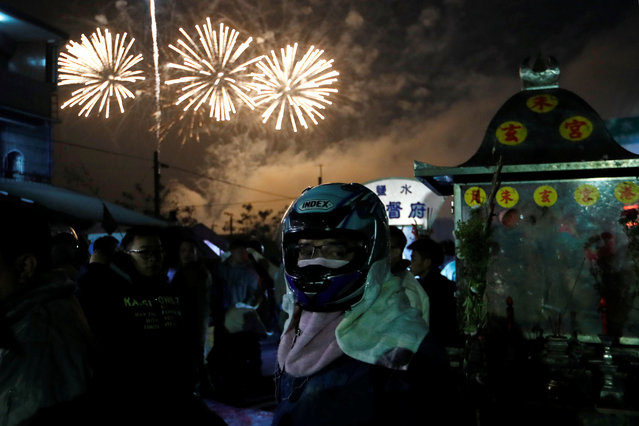 "Fireworks light up the sky during the ""Beehive Firecrackers"" festival at the Yanshui district in Tainan, Taiwan on March 1, 2018. (Photo by Tyrone Siu/Reuters)"