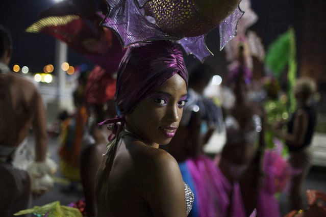 A reveler smiles before performing at a carnival parade in Havana August 8, 2014. Picture taken August 8, 2014. (Photo by Alexandre Meneghini/Reuters)