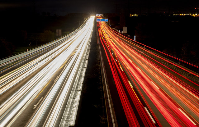 Traffic runs as usual on a highway in Frankfurt, Germany, Monday, November 2, 2020. A one month long partial lockdown becomes effective in Germany on Monday. (Photo by Michael Probst/AP Photo)