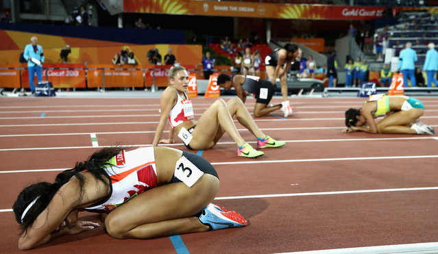 Overall gold medalist Katarina Johnson-Thompson of England (L) reacts after the Women's Heptathlon 800 metres during athletics on day nine of the Gold Coast 2018 Commonwealth Games at Carrara Stadium on April 13, 2018 on the Gold Coast, Australia. (Photo by Cameron Spencer/Getty Images)