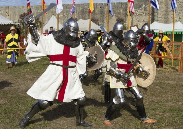 "Members of UK team fight during the ""Battle of Nations"" in Aigues-Mortes, southern France, Friday, May 10, 2013 where Middle Ages fans attend the historical medieval battle competition. The championship will be attended by 22 national teams, which is twice the number it was last year. The battle lasts until May 12.(Photo by Philippe Farjon/AP Photo)"
