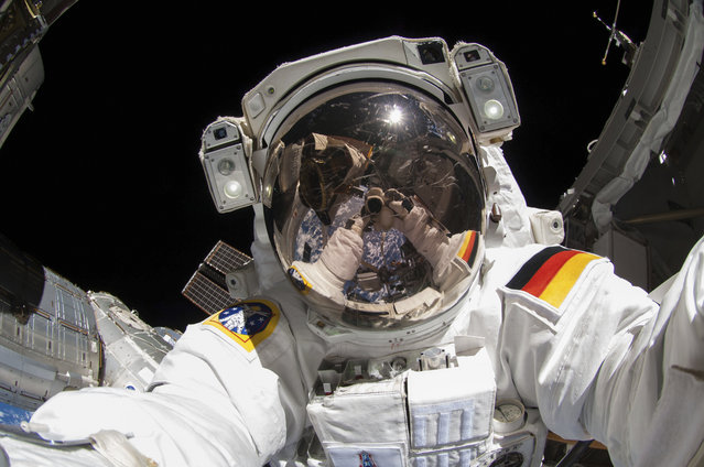 European Space Agency astronaut taking a photograph of his visor during extravehicular activity (EVA) on the International Space Station (ISS) on October 10, 2014. (Photo by NASA/SPL/Barcroft Media)