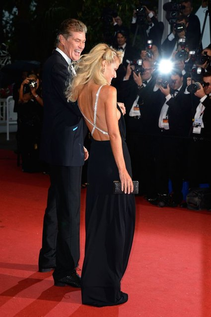"""David Hasselhoff (L) and Hayley Roberts attends the Opening Ceremony and """"The Great Gatsby"""" Premiere during the 66th Annual Cannes Film Festival at the Theatre Lumiere on May 15, 2013 in Cannes, France. (Photo by Pascal Le Segretain/Getty Images)"""