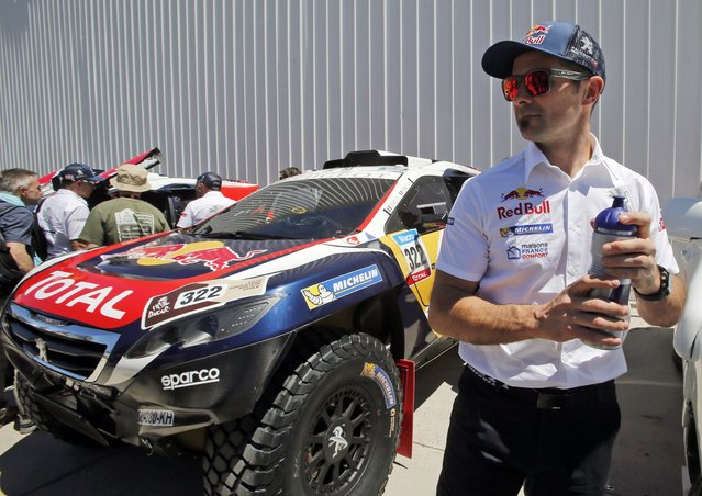 France's Cyril Despres arrives with his Peugeot car for the technical verification exercise ahead of the Dakar Rally 2015 in Buenos Aires January 2, 2015. (Photo by Jean-Paul Pelissier/Reuters)