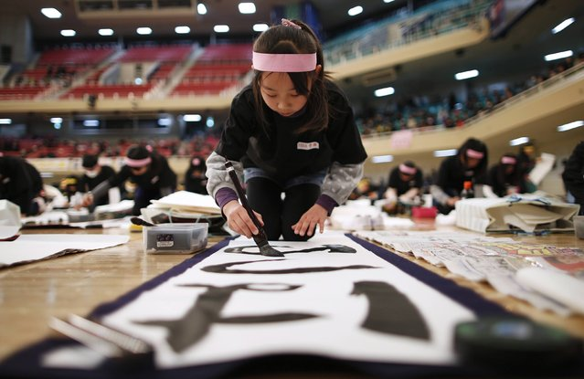 A Japanese girl participates in a calligraphy contest to the celebrate the New Year in Tokyo January 5, 2015. (Photo by Issei Kato/Reuters)