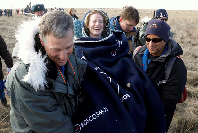Rescue team members carry International Space Station (ISS) crew member Kate Rubins of the U.S. shortly after the landing of the Russian Soyuz MS space capsule near the town of Dzhezkazgan (Zhezkazgan), Kazakhstan, October 30, 2016. (Photo by Dmitri Lovetsky/Reuters)