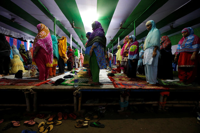 "Muslim women take part in evening prayers called ""Tarawih"", during the holy fasting month of Ramadan, inside a temporary platform in Kolkata, India, May 24, 2018. (Photo by Rupak De Chowdhuri/Reuters)"