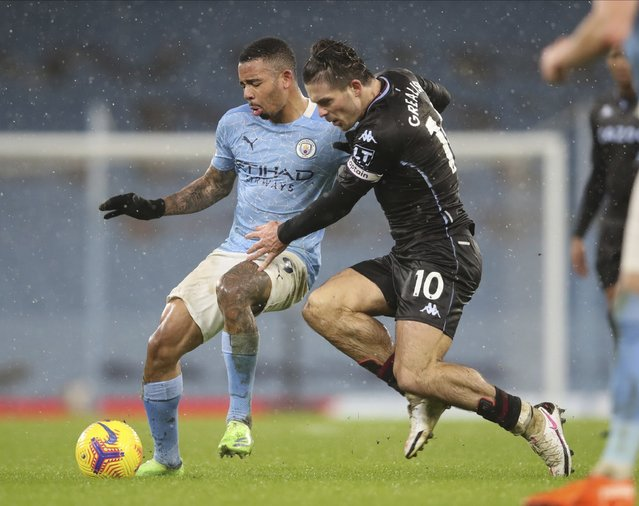 Aston Villa's Jack Grealish, right, and Manchester City's Gabriel Jesus challenge for the ball during the English Premier League soccer match between Manchester City and Aston Villa at the Etihad Stadium in Manchester, England, Wednesday, January 20, 2021. (Photo by Clive Brunskill/Pool via AP Photo)