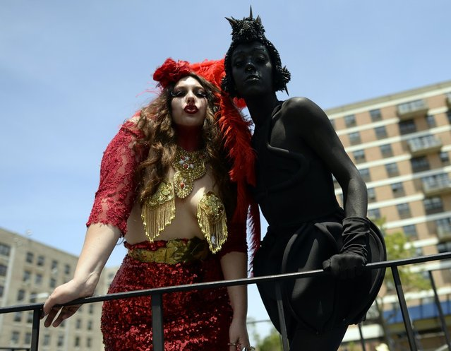 Parade participants arrive in costume for the 31st Annual Mermaid Parade at New York's Coney Island on June 22, 2103. Over 700,00 people are exptected to turn out for the  scantily clad parade.       AFP PHOTO / TIMOTHY CLARY        (Photo credit should read TIMOTHY CLARY/AFP/Getty Images)