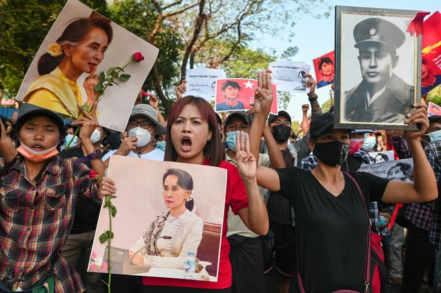 People show the three-finger salute as they rally in a protest against the military coup and to demand the release of elected leader Aung San Suu Kyi, in Yangon, Myanmar, February 8, 2021. (Photo by Reuters/Stringer)
