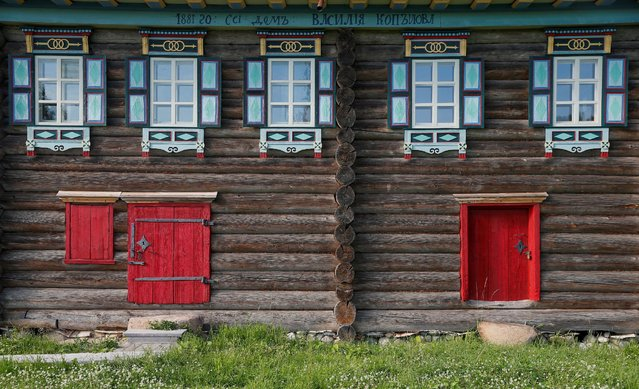 A view of a part of facade of a house moved from the village of Korostilevo, Syamzha District to Vologda Open Air Museum of Architecture and Ethnography in the village of Semenkovo outside Vologda, Russia, July 15, 2016. (Photo by Maxim Shemetov/Reuters)
