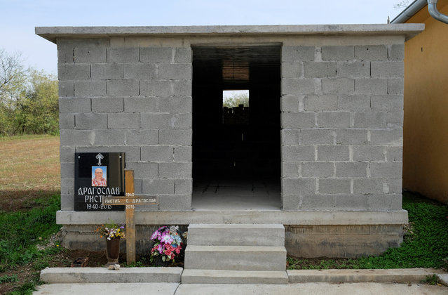 An unfinished chapel is seen at a cemetery in the village of Sapine, Serbia, October 25, 2016. (Photo by Marko Djurica/Reuters)