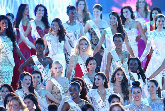 Albijona Muharremaj (C) Miss World Germany attends the Miss World Grand Final in Sanya, in southern China's Hainan province on December 19, 2015. (Photo by Johannes Eisele/AFP Photo)