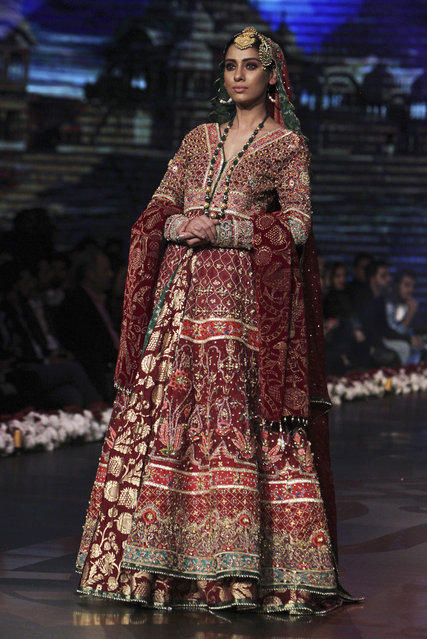 A model presents a bridal creation by designer Wardha Saleem during Bridal Couture Week 2016 in Lahore, Pakistan, Sunday, November 27, 2016. (Photo by K.M. Chaudary/AP Photo)