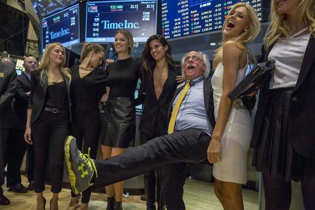 Trader Peter Tuchman (3rd R) poses with Sports Illustrated swimsuit models (L-R) Ashley Smith, Hannah Ferguson, Hailey Clauson, Sara Sampaio, and Kelly Rohrbach on the floor of the New York Stock Exchange February 6, 2015. (Photo by Brendan McDermid/Reuters)