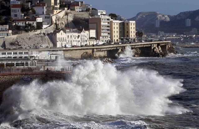 A high wave hits the waterfront in Marseille, France as stormy weather with high winds hits part of the French Mediterranean coast January 11, 2016. (Photo by Jean-Paul Pelissier/Reuters)