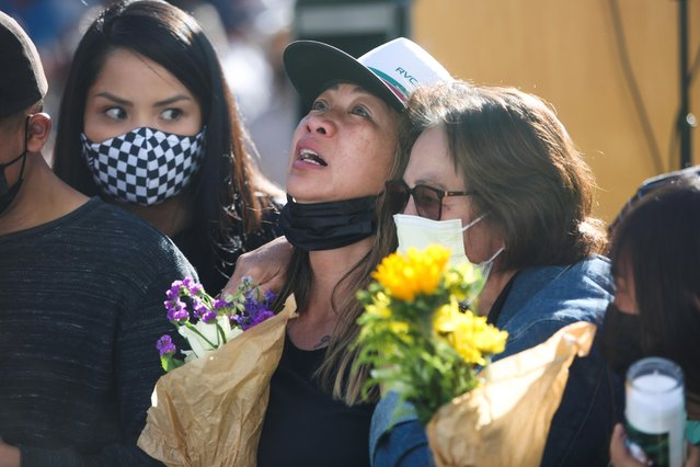 Family members of Paul Delacruz Megia mourn at a vigil for victims of a shooting at a rail yard run by the Santa Clara Valley Transportation Authority in San Jose, California, U.S., May 27, 2021. (Photo by Brittany Hosea-Small/Reuters)