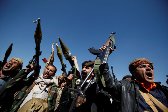 Pro-Houthi tribesmen hold up their weapons as they shout slogans during a gathering held to mobilize fighters for the battles against government forces, in Sanaa, Yemen November 24, 2016. (Photo by Khaled Abdullah/Reuters)