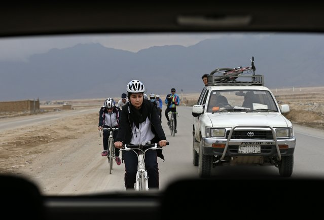 Zhala, a member of Afghanistan's Women's National Cycling Team trains with others on the outskirts of Kabul February 20, 2015. (Photo by Mohammad Ismail/Reuters)