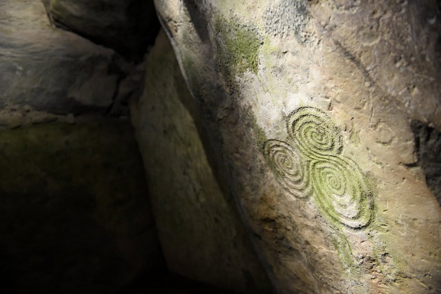 A neolithic engraving is seen during winter solstice inside the 5000 year old stone age tomb of Newgrange in the Boyne Valley at sunrise in Newgrange, Ireland, December 21, 2016. (Photo by Clodagh Kilcoyne/Reuters)