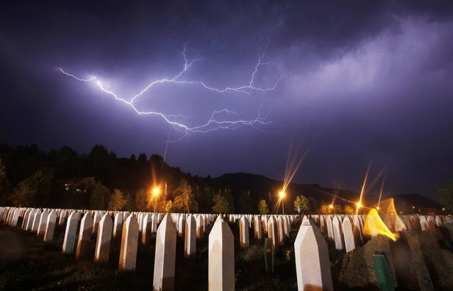 Lightning is seen during a storm under the Memorial Center in Potocari the night before a mass burial of recently identified victims of the Srebrenica massacre, near Srebrenica in this July 10, 2012 file photo. Serbia arrested seven men on March 18, 2015 suspected of taking part in the 1995 Srebrenica massacre in Bosnia, the first such arrests in the ex-Yugoslav republic of accused gunmen in Europe's worst atrocity since World War Two. (Photo by Dado Ruvic/Reuters)