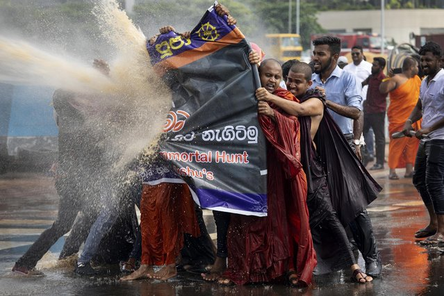 Police fire teargas and use water cannons to disperse the Sinhala extremist monks from Bodu Bala Sena (BBS) on November 19, 2018 in Colombo, Sri Lanka. The monks came to meet with Sri Lanka's president to hand over a message calling for the release of (BBS) General Secretary Ven. Galagoda Aththe Gnanasara Thera who was sentenced to six years in prison. Sri Lankas president later apologized for the severe treatment of the protesters. (Photo by Paula Bronstein/Getty Images)