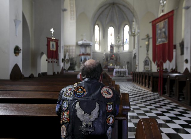 A motorist prays in church during the first gathering of motorists at the beginning of the spring season in Mirna Pec April 6, 2015. (Photo by Srdjan Zivulovic/Reuters)