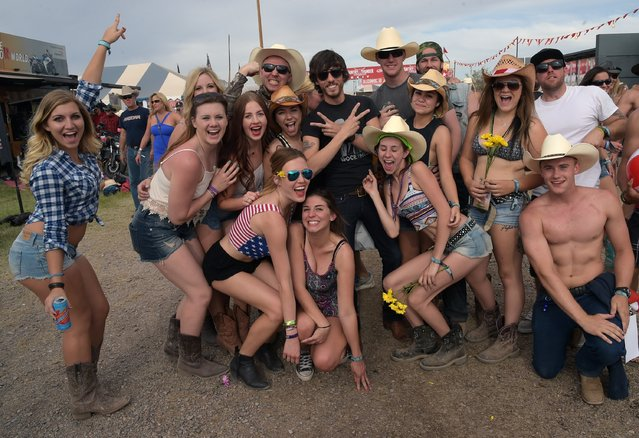 Singer/Songwriter Chris Janson (center black shirt) with fans during Country Thunder USA – Day 3 on April 11, 2015 in Florence, Arizona. (Photo by Rick Diamond/Getty Images for Country Thunder USA)