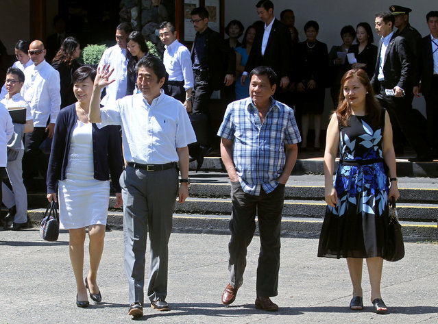 Japan's Prime Minister Shinzo Abe (2nd L), his wife, Akie Abe (L), Philippine President Rodrigo Duterte (2nd R), and his partner, Honeylet Avancena, walk towards the garden area of Waterfront Insular Hotel in Davao City, southern Philippines January 13, 2017. (Photo by Reuters/Malacanang Photo)