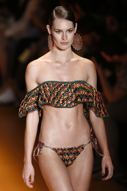 A model wears a creation from Agua de Coco Summer collection during the Sao Paulo Fashion Week in Sao Paulo, Brazil, Tuesday, April 14, 2015. (Photo by Andre Penner/AP Photo)