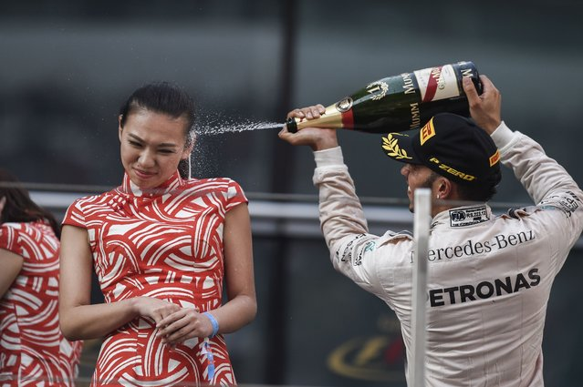Mercedes AMG Petronas F1 Team's British driver Lewis Hamilton celebrates after winning the Formula One Chinese Grand Prix in Shanghai on April 12, 2015. (Photo by Fred Dufour/AFP Photo)