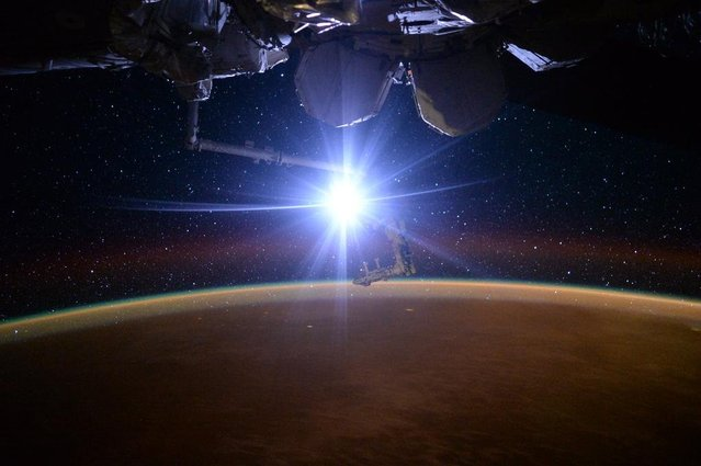 """Astronaut Scott Kelly posted this photo taken from the International Space Station October 13, 2015 on Twitter with the caption, """"Day 200. Sometimes a little light makes all the difference. #GoodNight from @Space_Station #YearInSpace"""". (Photo by Scott Kelly/NASA)"""