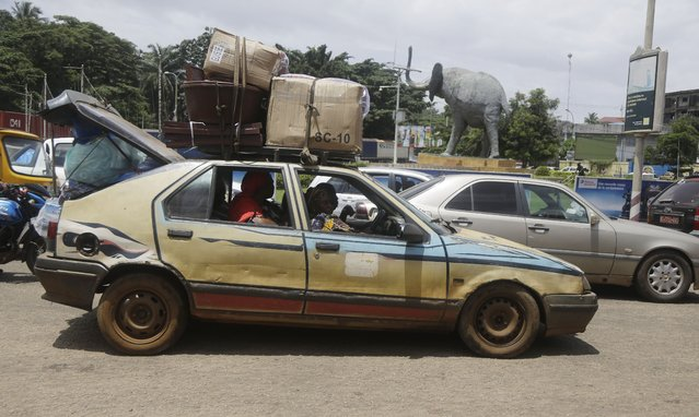 People travel in a taxi in Conakry, Guinea, Thursday, September 9, 2021. (Photo by Sunday Alamba/AP Photo)