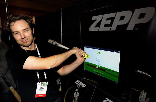 Matt Brown demonstrates US company ZEPP multi-sensor sports systems during the unveiled press preview event for the 2014 International Consumer Electronics Show (CES) at the Mandalay Bay Convention Center in Las Vegas, Nevada, USA, 06 January 2014. (Photo by Michael Nelson/EPA)