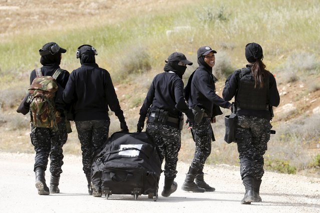 Members of the Jordanian police women team leave after they competed in the 7th Annual Warrior Competition at the King Abdullah Special Operation Training Center in Amman April 20, 2015. (Photo by Muhammad Hamed/Reuters)