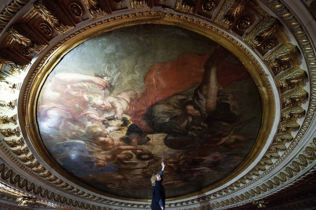 """Conservationist Sarah Pinchin, 41, inspects her teams work on Rubens ceiling painting """"Apotheosis of James 1st"""" during restoration work at Banqueting House on March 1, 2016 in London, England. (Photo by Chris Ratcliffe/Getty Images)"""