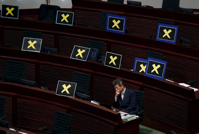 Lawmaker Ronny Tong sits beside placards left by pro-democracy lawmakers, after they left to boycott Hong Kong Chief Secretary Carrie Lam during a Legislative Council meeting in Hong Kong April 22, 2015. The Hong Kong government unveiled a long-awaited electoral blueprint for selecting the city's next leader to lawmakers on Wednesday, in a plan that reflected China's desire for a tightly controlled poll that is likely to rile democracy activists. (Photo by Bobby Yip/Reuters)