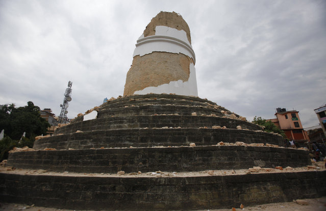 The historic Dharahara tower, a city landmark, stands destroyed after an earthquake in Kathmandu, Nepal, Saturday, April 25, 2015. (Photo by Niranjan Shrestha/AP Photo)