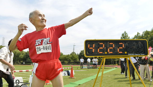 105-year-old Japanese Hidekichi Miyazaki poses like Jamaica's Usain Bolt in front of an electric board showing his 100-metre record time of 42.22 seconds at an athletic field in Kyoto, Japan, in this photo taken by Kyodo September 23, 2015. Japanese centenarian Hidekichi Miyazaki set a record as the world's oldest competitive sprinter this week, one day after turning 105, but said he was disappointed at falling short of his own personal best. (Photo by Reuters/Kyodo News)