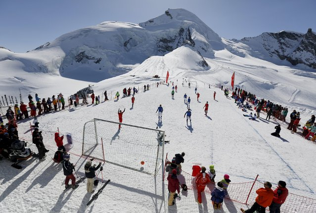 Amateur soccer players from Switzerland play against Italy during the Euro 2016 of the Mountain Villages soccer tournament on the Allalin glacier in Saas-Fee, Switzerland March 12, 2016. (Photo by Ruben Sprich/Reuters)