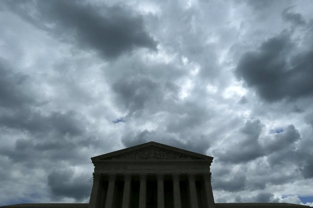 A cloudy sky aboce the U.S. Supreme Court building the day before arguments in the same-s*x marriage case Obergefell v. Hodges, is pictured in Washington April 27, 2015. (Photo by Jonathan Ernst/Reuters)