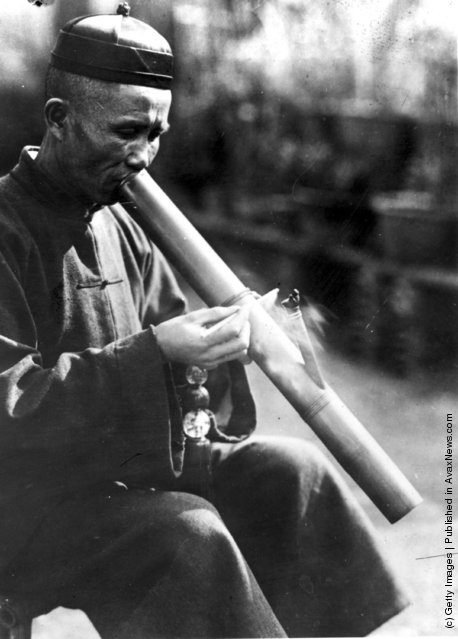 March 1932:  An opium smoker in China