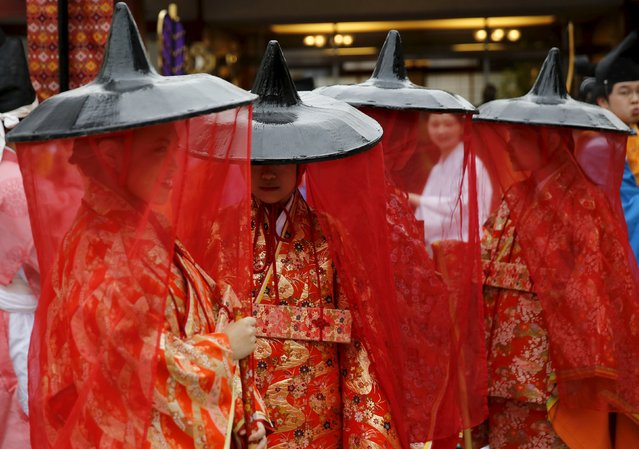 Women in traditional costumes gather before a ritual for the Kanda festival at the Kanda-Myojin shrine in Tokyo May 9, 2015. (Photo by Toru Hanai/Reuters)